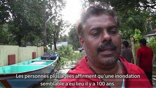 En Inde, des sauveteurs luttent contre les inondations